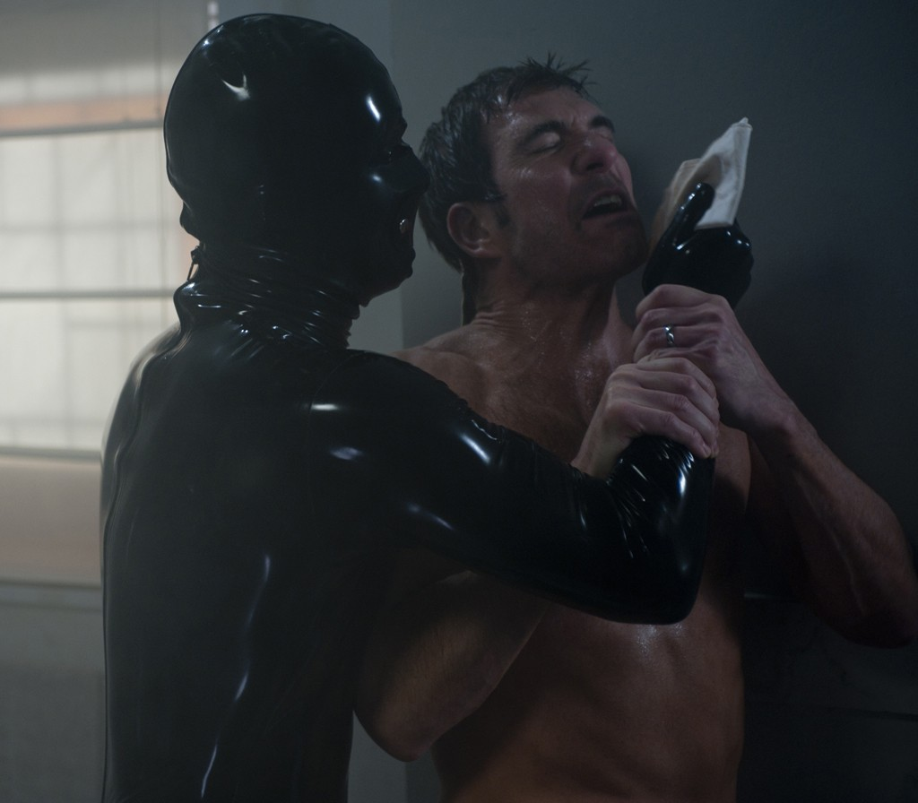 AMERICAN HORROR STORY: Episode 10 - SMOLDERING CHILDREN (Airs December 7, 10:00 pm e/p). Pictured L-R: Dylan McDermott and Robber Man. CR: Lewis Jacobs / FX